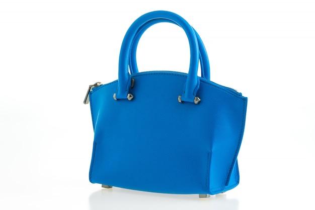 Piękna elegancja i luksusowe kobiety modne i niebieska torebka