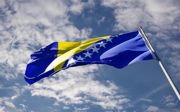 Piękna flaga państwowa bośni i hercegowiny na niebie