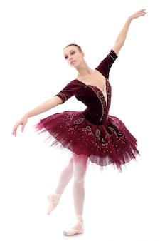 Piękna i piękna baletnica w pozie baletowej