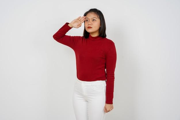 Piękna indonezyjska kobieta pozdrawiający gest