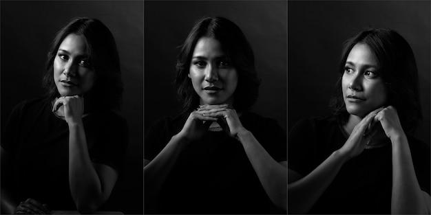 Piękna kobieta ma proste, czarne włosy i wyraża szczęśliwy uśmiech. azjatycka dziewczyna pokazuje oczy wyraz twarzy na ciemnym tle, portret pół ciała monotonny