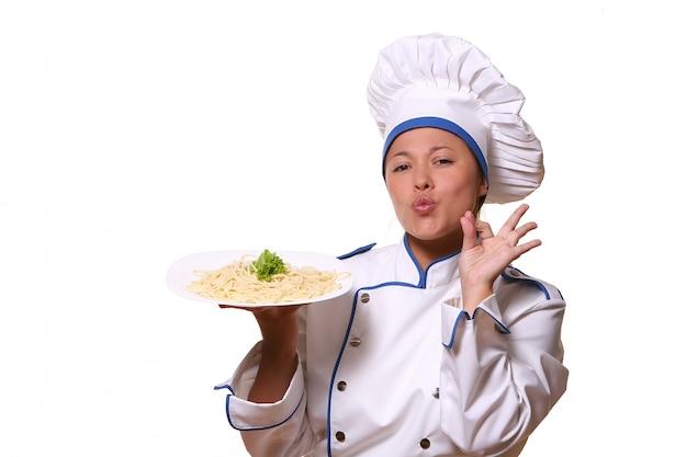 Piękna kobieta w wizerunku szefa kuchni