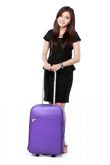 Piękna młoda biznesowa kobieta z walizką