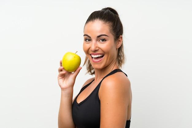 Piękna młoda dziewczyna z jabłkiem