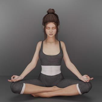 Piękna młoda kobieta siedzi w pozycji jogi i medytacji ze ścieżką klikania.