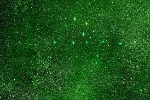 Piękna przestrzeń, gromada gwiazd i galaktyk. w kolorze zielonym. elementy tego obrazu dostarczyła nasa. w dowolnym celu.