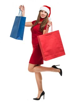 Piękna święty mikołaj kobiety mienia torba na zakupy