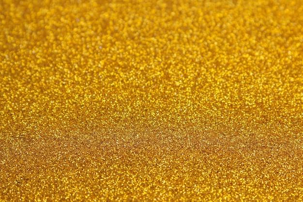 Piękna tekstura żółtych iskier. tło brokat. błyszcząca tekstura