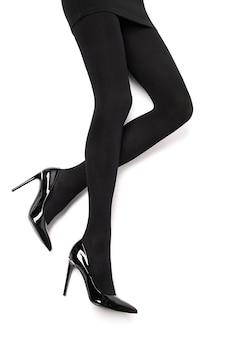 Piękne długie smukłe seksowne kobiece nogi czarne majtki i pończochy