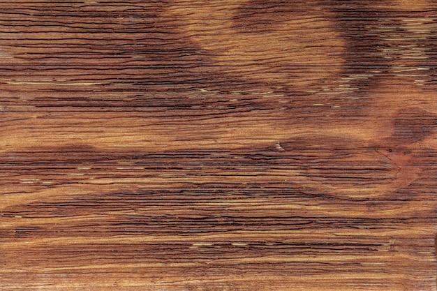 Piękne drewno ze złotymi tonami.
