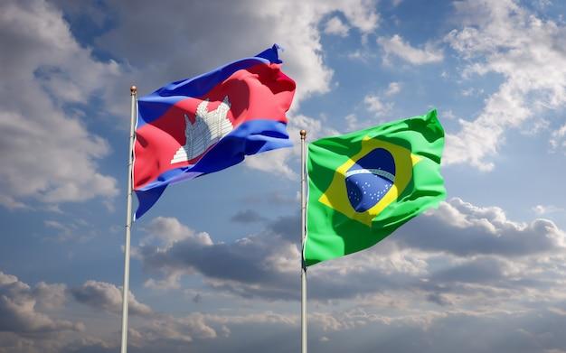 Piękne flagi państwowe brazylii i kambodży razem na błękitne niebo