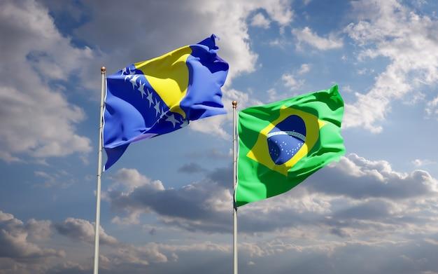 Piękne flagi państwowe brazylii oraz bośni i hercegowiny razem na błękitnym niebie