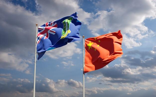 Piękne flagi państwowe chin i brytyjskich wysp dziewiczych razem na niebie