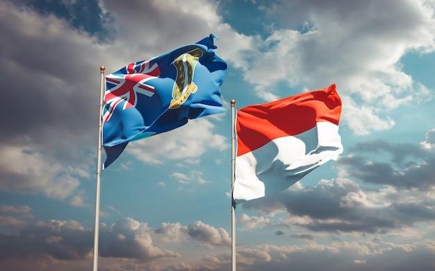 Piękne flagi państwowe indonezji i brytyjskich wysp dziewiczych razem na błękitnym niebie