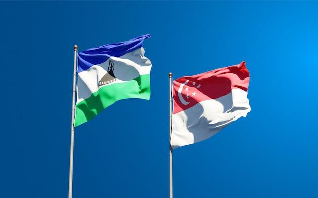 Piękne flagi państwowe lesotho i singapuru razem