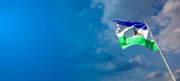 Piękne flagi państwowe lesotho z pustą przestrzenią na szerokim tle