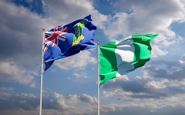 Piękne flagi państwowe nigerii i brytyjskich wysp dziewiczych razem na błękitnym niebie