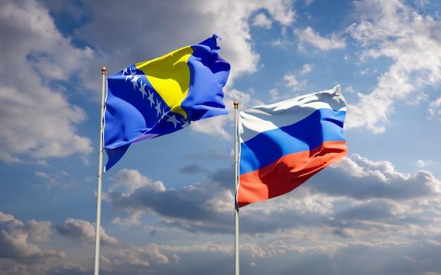 Piękne flagi państwowe rosji oraz bośni i hercegowiny razem na błękitnym niebie. grafika 3d