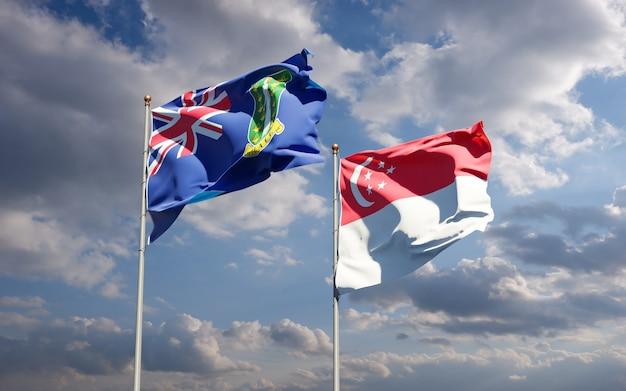 Piękne flagi państwowe singapuru i brytyjskich wysp dziewiczych
