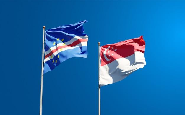 Piękne flagi państwowe singapuru i republiki zielonego przylądka