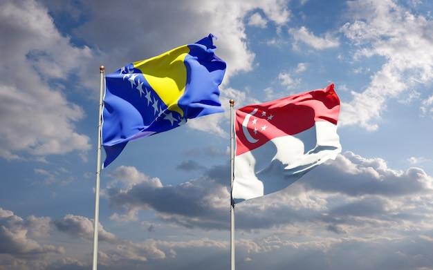 Piękne flagi państwowe singapuru oraz bośni i hercegowiny