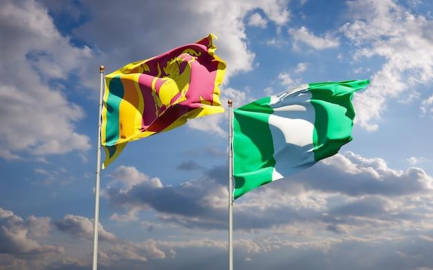 Piękne flagi państwowe sri lanki i nigerii razem na błękitnym niebie