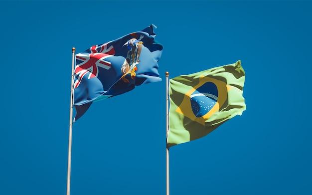 Piękne flagi państwowe stanu georgia południowa i sandwich południowy i brazylii razem na błękitne niebo