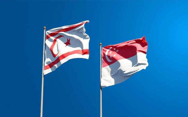 Piękne flagi państwowe tureckiej republiki cypru północnego i singapuru