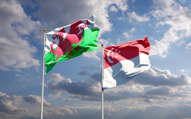 Piękne flagi państwowe walii i singapuru razem