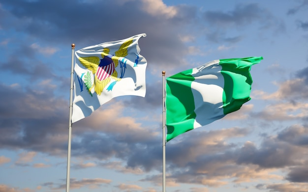 Piękne flagi państwowe wysp dziewiczych stanów zjednoczonych i nigerii razem na błękitne niebo