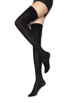 Piękne kobiece nogi w pończochach