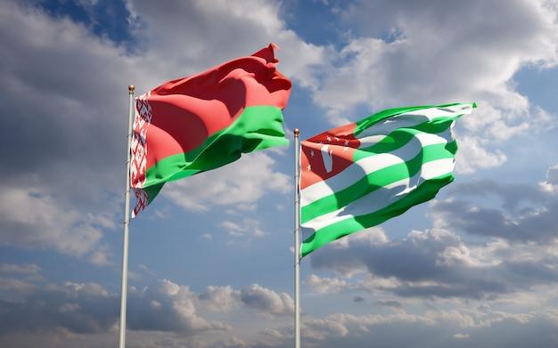 Piękne narodowe flagi państwowe abchazji i białorusi razem