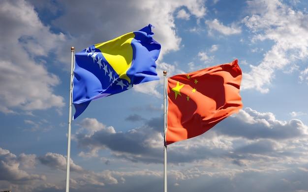 Piękne narodowe flagi państwowe chin oraz bośni i hercegowiny razem na niebie