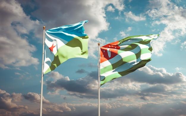 Piękne narodowe flagi państwowe dżibuti i abchazji razem