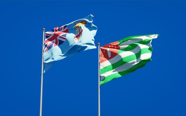 Piękne narodowe flagi państwowe fidżi i abchazji razem