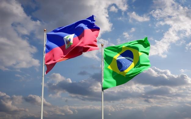 Piękne narodowe flagi państwowe haiti i brazylii razem na błękitnym niebie