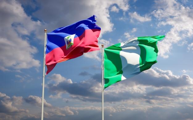 Piękne narodowe flagi państwowe haiti i nigerii razem na błękitnym niebie