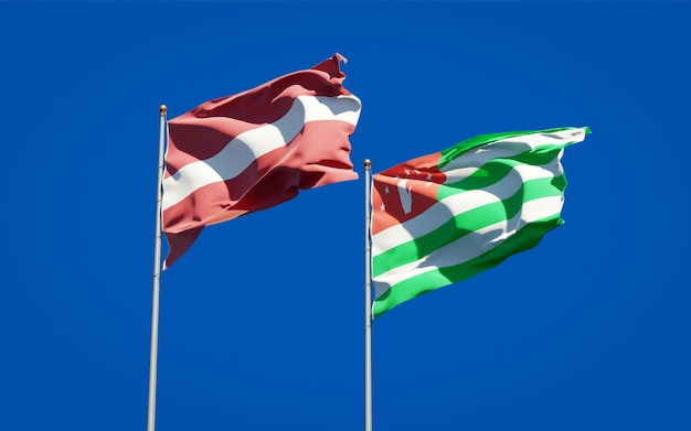 Piękne narodowe flagi państwowe łotwy i abchazji razem