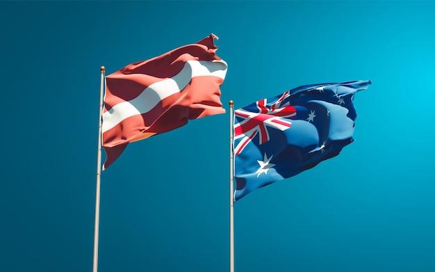 Piękne narodowe flagi państwowe łotwy i australii razem