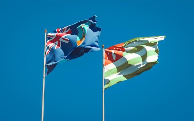Piękne narodowe flagi państwowe montserrat i abchazji razem na błękitnym niebie. grafika 3d