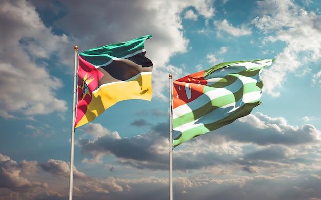 Piękne narodowe flagi państwowe mozambiku i abchazji razem