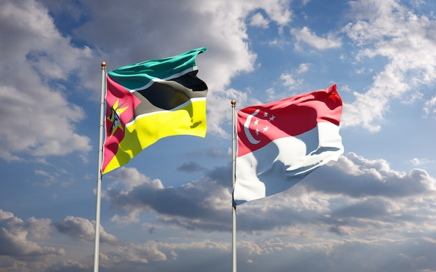 Piękne narodowe flagi państwowe mozambiku i singapuru razem