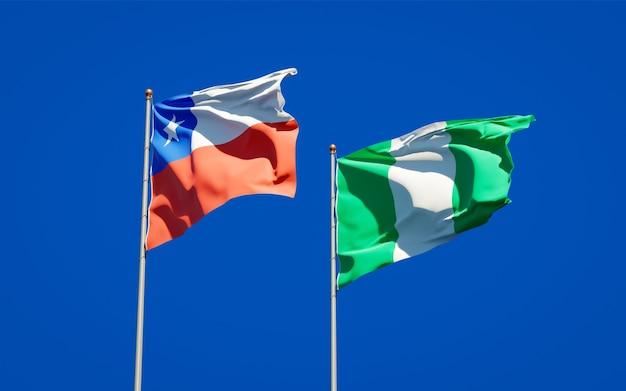 Piękne narodowe flagi państwowe nigerii i chile razem na błękitnym niebie