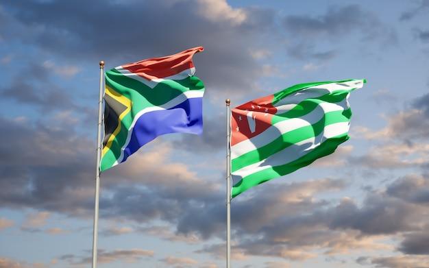 Piękne narodowe flagi państwowe republiki południowej afryki i abchazji razem