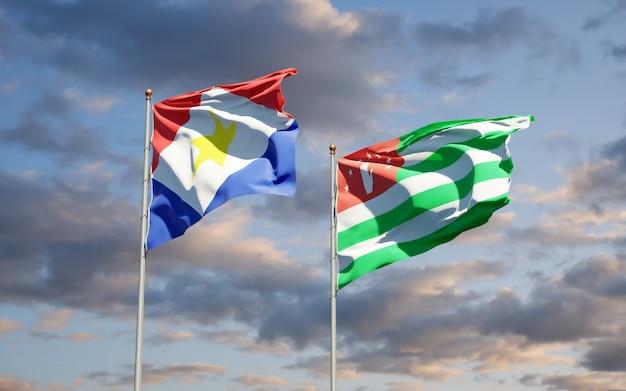 Piękne narodowe flagi państwowe saba i abchazji razem na błękitnym niebie. grafika 3d