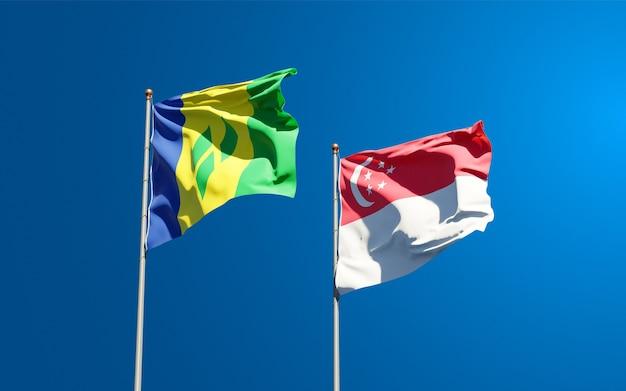 Piękne narodowe flagi państwowe saint vincent i grenadyny oraz singapur razem