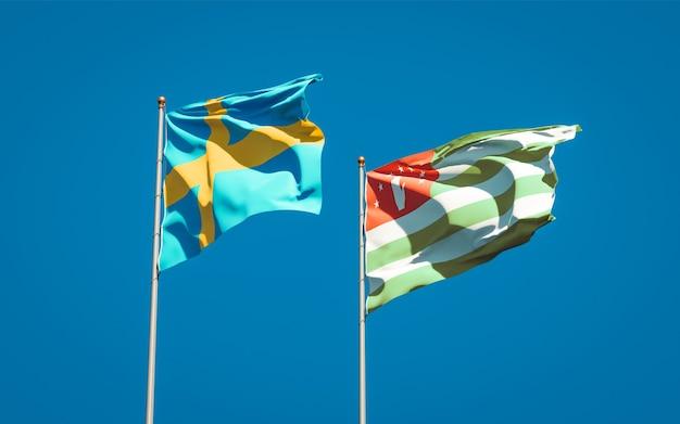 Piękne narodowe flagi państwowe szwecji i abchazji razem