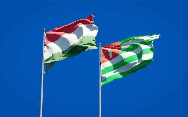 Piękne narodowe flagi państwowe węgier i abchazji razem