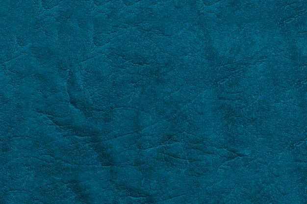 Piękne niebieskie tło z prawdziwej skóry. powierzchnia tekstur z wzorem.