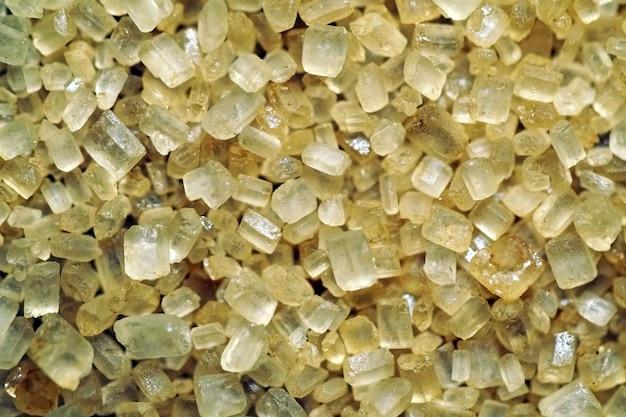 Piękne zbliżenie strzał makro żółty cukier trzcinowy - idealne do tła